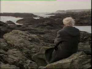 RS Thomas in a Welsh landscape seen on the back