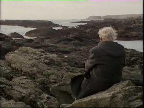 R.S. Thomas in a Welsh landscape seen on the back